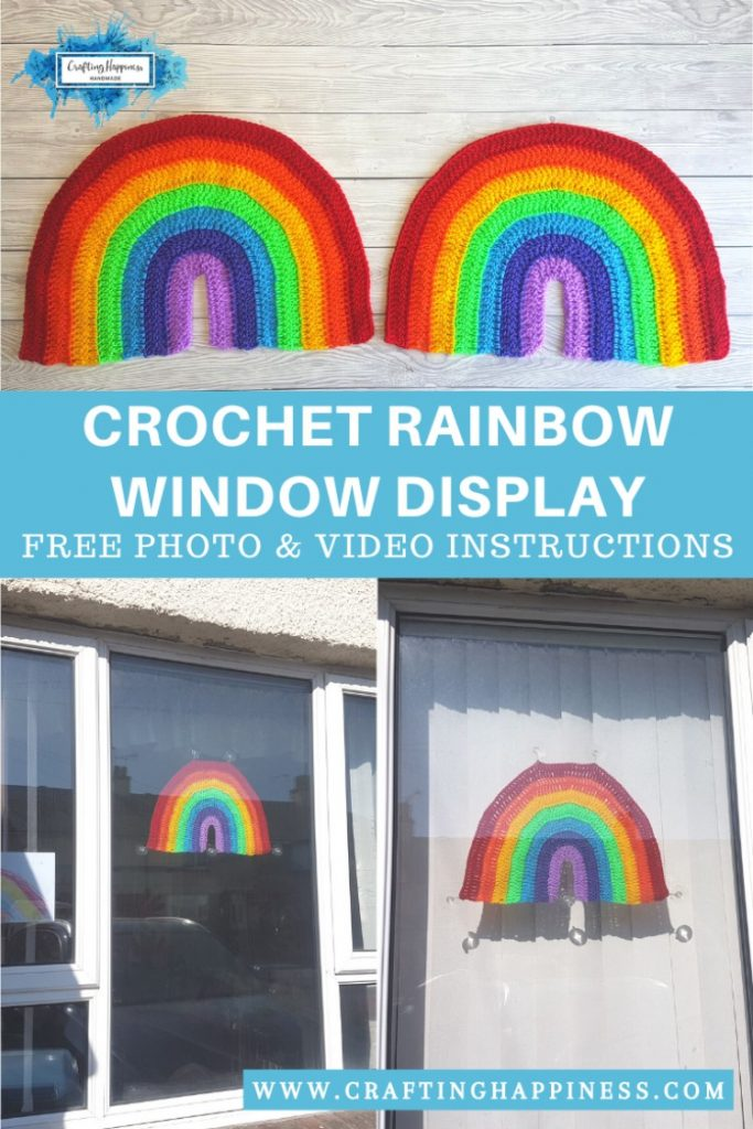 A crochet rainbow displayed in the window as decoration