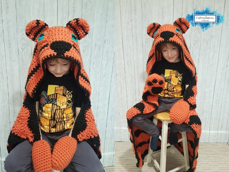 Hooded tiger blanket with orange and black strips for adults and kids crochet pattern by Crafting Happiness