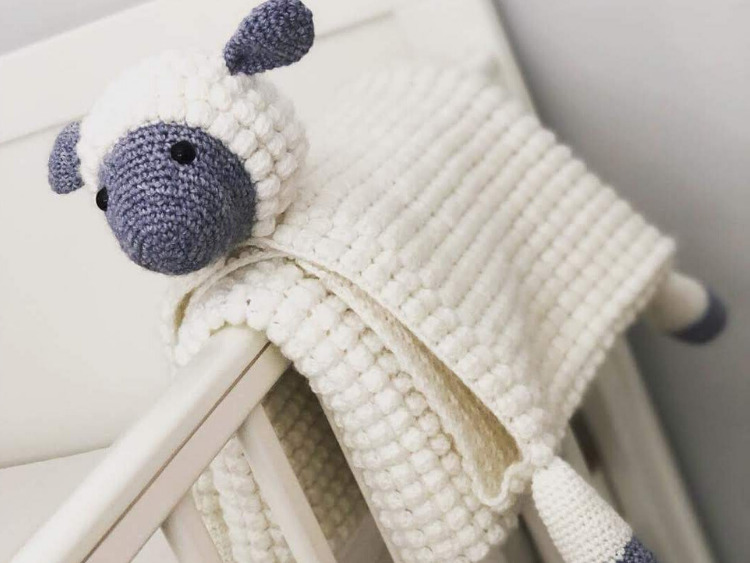 a cute baby blanket that folds into a sheep toy